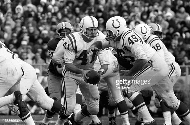 NFL Playoffs Baltimore Colts QB Tom Matte in action handoff to Jerry Hill vs Green Bay Packers at Lambeau Field Green Bay WI CREDIT Neil Leifer
