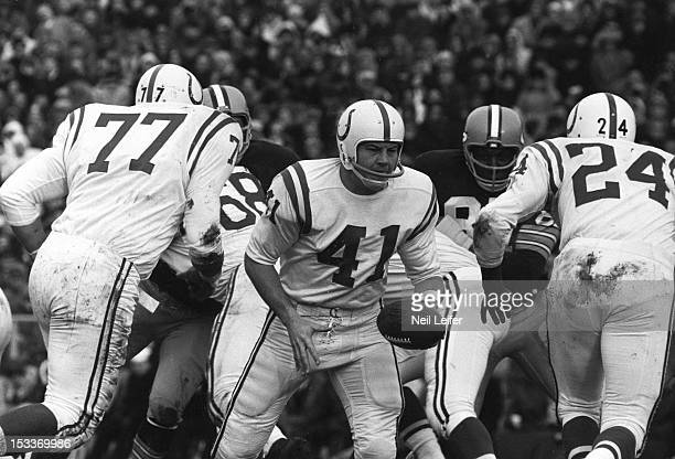 NFL Playoffs Baltimore Colts QB Tom Matte in action handoff to Lenny Moore vs Green Bay Packers at Lambeau Field Green Bay WI CREDIT Neil Leifer