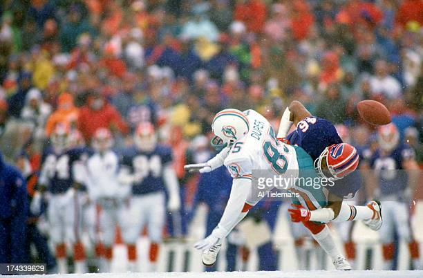 NFL Playoffs Buffalo Bills Leonard Smith in action defense vs Miami Dolphins Mark Duper at Rich Stadium Weather snow Orchard Park NY CREDIT Al...