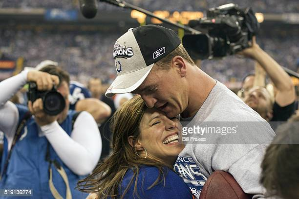 NFL Playoffs Closeup of Indianapolis Colts QB Peyton Manning victorious hugging wife Ashley after winning game vs New England Patriots at RCA Dome...