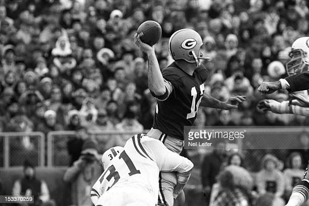 NFL Playoffs Green Bay Packers QB Zeke Bratkowski in action making pass under pressure vs Baltimore Colts Steve Stonebreaker at Lambeau Field Green...