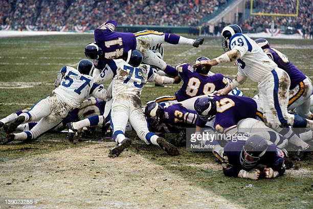 NFL Playoffs Los Angeles Rams Doug Woodlief and Deacon Jones in action tackle vs Minnesota Vikings Dave Osborn at Metropolitan Stadium Bloomington MN...