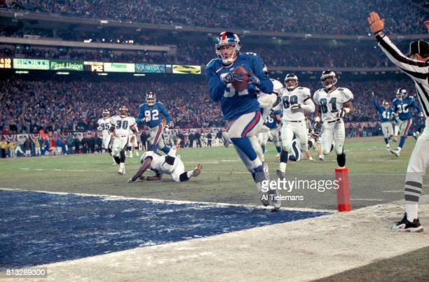 NFL Playoffs New York Jason Sehorn in action returning interception for touchdown vs Philadelphia Eagles at Giants Stadium East Rutherford NJ CREDIT...