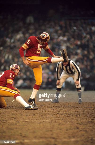 NFL Playoffs Washington Redskins Curt Knight in action kicking with Sam Wyche holding vs Green Bay Packers at RFK Memorial Stadium Washington DC...