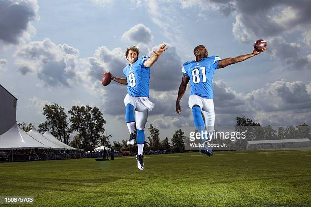 Season Preview: Portrait of Detroit Lions QB Matthew Stafford and wide receiver Calvin Johnson posing during photo shoot at Lions Headquarters &...