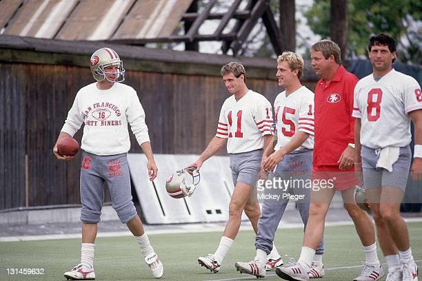 NFL Strike San Francisco 49ers QB Joe Montana QB Bob Gagliano RB John Paye coach Mike Holmgren and QB Steve Young during practice session at Red...