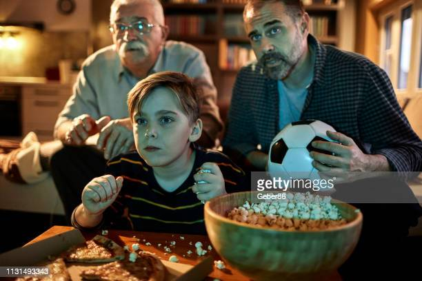 football night - family watching tv stock pictures, royalty-free photos & images