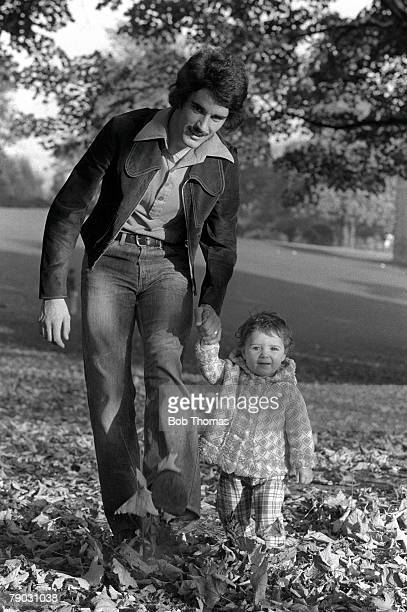 Football Northampton Town footballer John Gregory enjoying an Autumn walk with his baby daughter Luisa in Abington Park Northampton