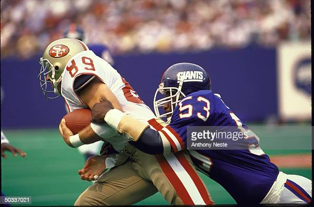 Giants Harry Carson in action vs SF 49ers Ron Heller.