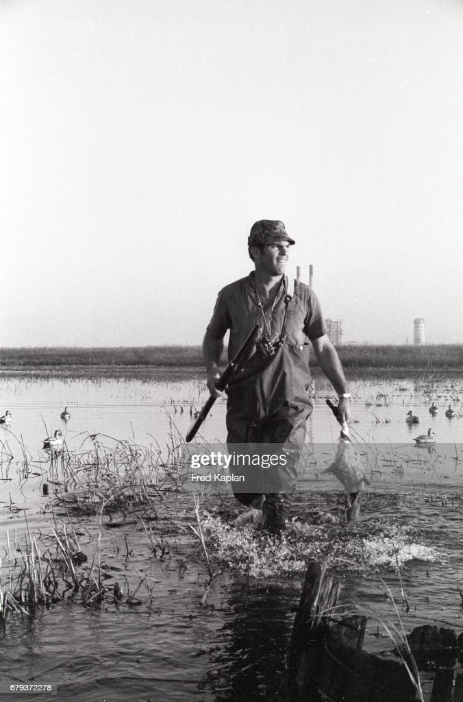 1307710b Oakland Raiders QB Daryle Lamonica in hunting attire, wading to ...