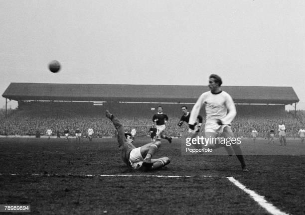 Football, Oakwell, Barnsley, February 1964, Barnslay v Manchester United, Manchester United's Denis Law chips the ball over the Barnsley goalkeeper