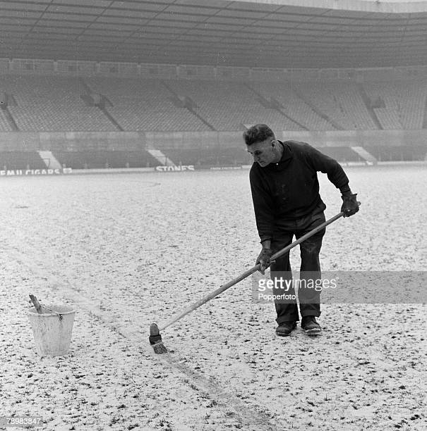Football Old Trafford Manchester England Circa 1965 A Manchester United groundsman marking the lines on the snowbound pitch