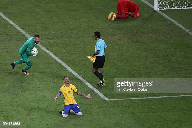 Day 15 Neymar of Brazil in tears after scoring the winning penalty kick as Goalkeeper Timo Horn of Germany lies distraught in the penalty area during...