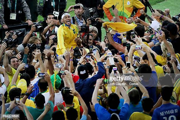 Day 15 Neymar of Brazil with supporters in the crowd after Brazil won a penalty shoot out during the Brazil Vs Germany Men's Football Gold Medal...
