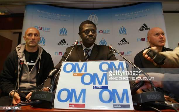 Football Olympique de Marseille president Pape Diouf speaks next to team captain Fabien Barthez and Sport director Jose Anigo 03 March 2006 in...