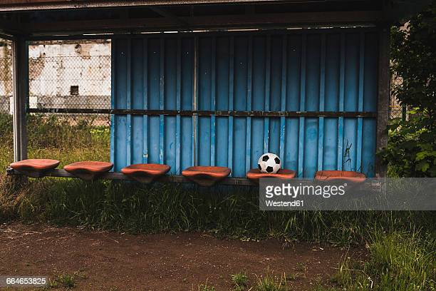 football on empty coaching bench - run down stock photos and pictures