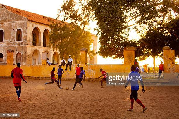 Football on the main square of Goree island, Senegal. Gor��e is both the smallest and the least populated of the 19 communes d'arrondissement of...