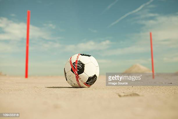 football on the sand on beach - goal post stock pictures, royalty-free photos & images