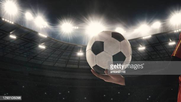 football or soccer player on full stadium and flashlights background - the championship football league stock pictures, royalty-free photos & images