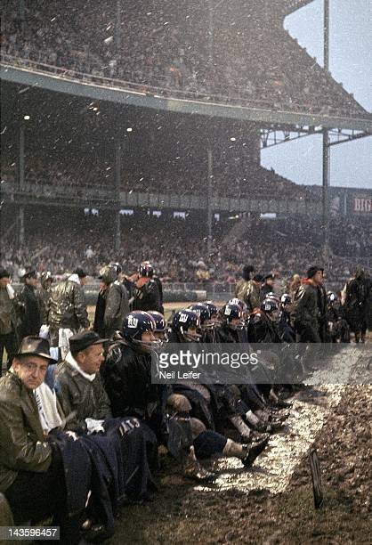 Overall view of stadium and New York Giants players on bench during game vs Philadelphia Eagles at Yankee Stadium Bronx NY CREDIT Neil Leifer
