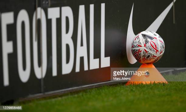 Football palace on a training cone alongside a Nike advertisement during the Emirates FA Cup Second Round match between Barnet FC and Milton Keynes...
