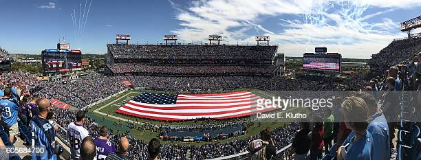 Panoramic view of American flag unfurled on field during national anthem before Tennessee Titans vs Minnesota Vikings game at Nissan Stadium Wide...