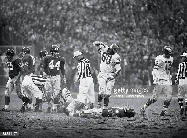 Football Philadelphia Eagles Chuck Bednarik victorious after making sack vs New York Giants Frank Gifford Bronx NY