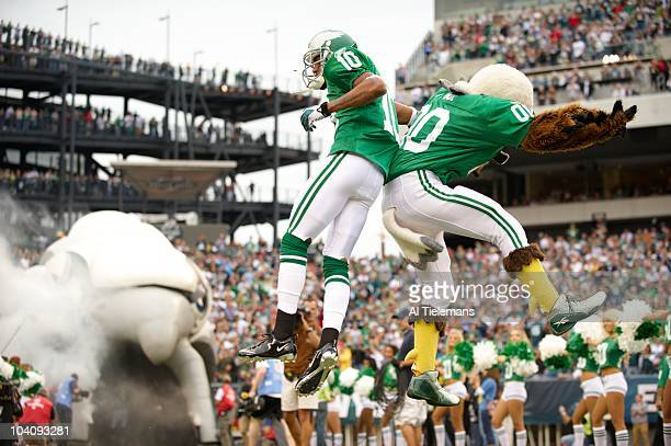 Philadelphia Eagles DeSean Jackson with mascot taking field before game vs Green Bay Packers Philadelphia PA 9/12/2010 CREDIT Al Tielemans