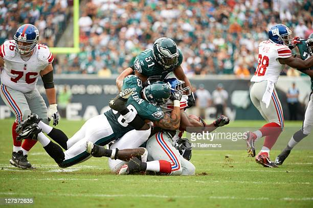 Philadelphia Eagles Jamar Chaney and Jason Babin in action tackle vs New York Giants Ahmad Bradshaw at Lincoln Financial Field Philadelphia PA CREDIT...