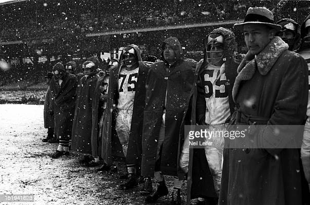 Philadelphia Eagles Jerry Huth Jim McCusker and teammates on sidelines during game vs Pittsburgh Steelers at Forbes Field Snow weather Pittsburgh PA...