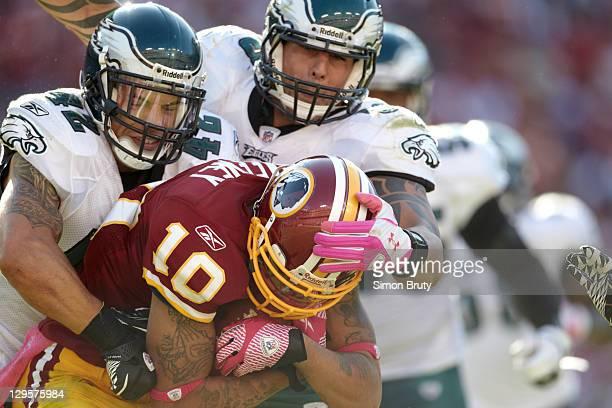 Philadelphia Eagles Kurt Coleman and Jason Babin in action making tackle vs Washington Redskins Jabar Gaffney at FedEx Field Landover MD CREDIT Simon...