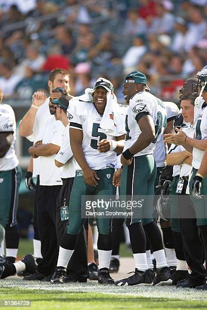 Football Philadelphia Eagles QB Donovan McNabb and Terrell Owens on sidelines during game vs San Francisco 49ers Cover Philadelphia PA 9/18/2005