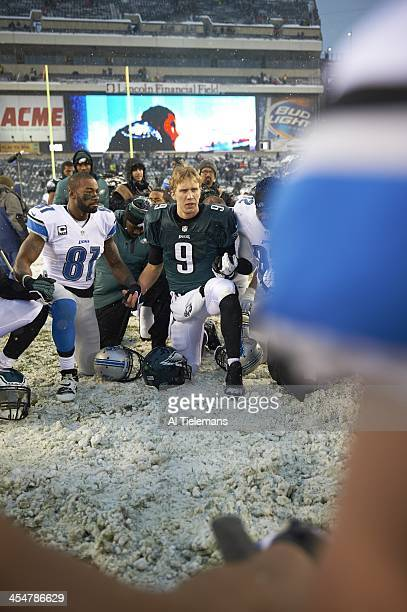 Philadelphia Eagles QB Nick Foles kneeling in prayer after winning game with Detroit Lions Calvin Johnsn at Lincoln Financial Field Snow weather...