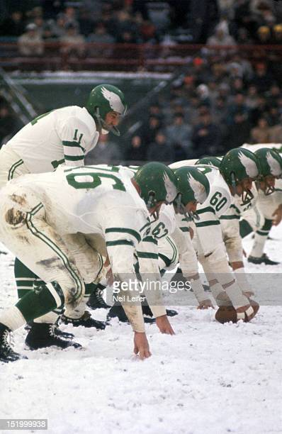 Philadelphia Eagles QB Norm Van Brocklin calling signals before snap during game vs Pittsburgh Steelers at Forbes Field Snow weather Pittsburgh PA...