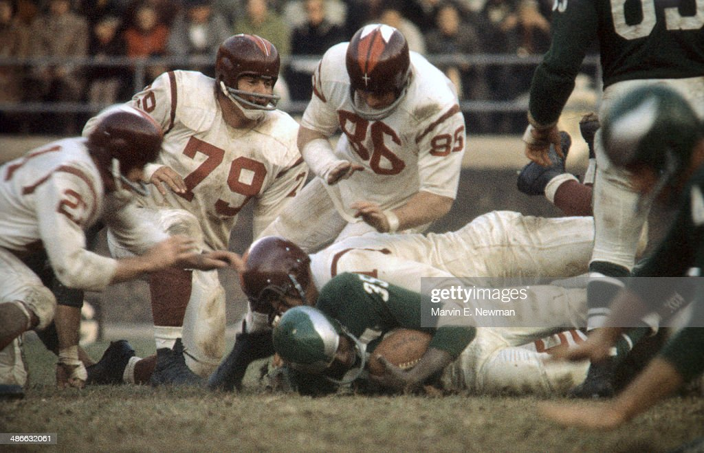 Philadelphia Eagles Ted Dean (35) in action under pile on tackle vs Washington Redskins John Paluck (86), Bob Toneff (79), and Gary Glick (21) at Franklin Field. Marvin E. Newman X7128 )