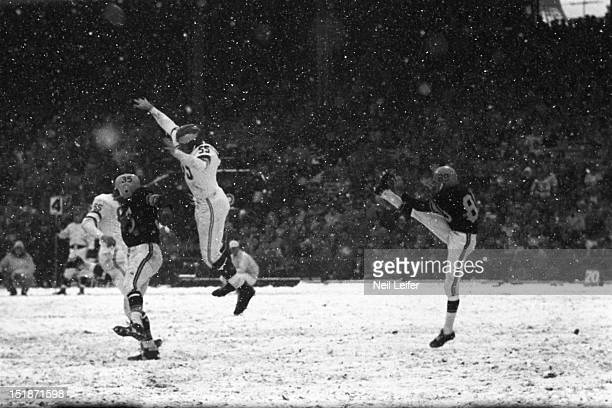 Pittsburgh Steelers Bobby Joe Green in action punt vs Philadelphia Eagles Maxie Baughan at Forbes Field Snow weather Pittsburgh PA CREDIT Neil Leifer