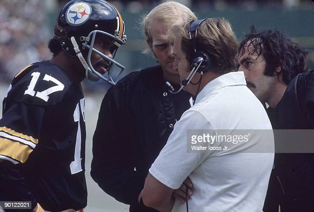 Pittsburgh Steelers coach Chuck Noll talking with QB Joe Gilliam and QB Terry Bradshaw on sidelines during game vs Baltimore Colts Pittsburgh PA...