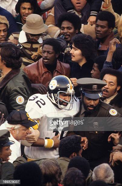 Pittsburgh Steelers Franco Harris leaving field with injury during game vs Oakland Raiders at Three Rivers Stadium Pittsburgh PA CREDIT Neil Leifer