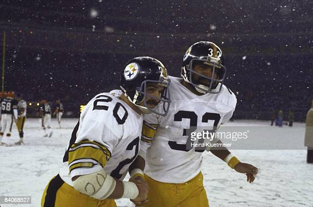 Pittsburgh Steelers Franco Harris victorious with and hugging Rocky Bleier during game vs Cincinnati Bengals Weather snow Cincinnati OH CREDIT Heinz...