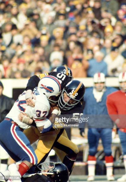 Pittsburgh Steelers Jack Ham in action tackling Buffalo Bills OJ Simpson at Three Rivers Stadium Pittsburgh PA CREDIT Heinz Kluetmeier