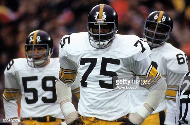 Pittsburgh Steelers Jack Ham Joe Greene and LC Greenwood on field during game vs New York Giants at Giants Stadium East Rutherford NJ CREDIT Walter...