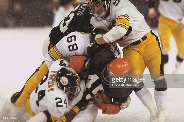 Football Pittsburgh Steelers Jack Ham LC Greenwood and JT Thomas in action making pileup tackle vs Cincinnati Bengals Archie Griffin Snow weather...