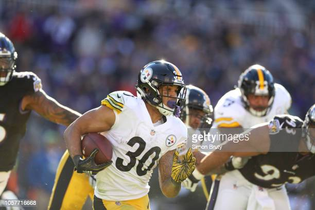 Pittsburgh Steelers James Conner in action rushing vs Baltimore Ravens at MT Bank Stadium Baltimore MD CREDIT Simon Bruty