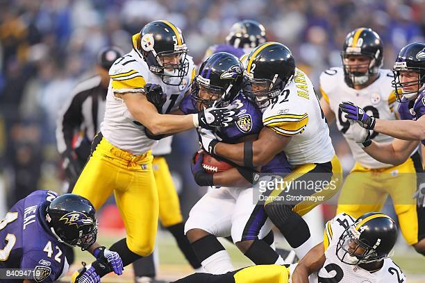 Pittsburgh Steelers James Farrior and James Harrison in action, making tackle vs Baltimore Ravens Le'Ron McClain . Baltimore, MD CREDIT: Damian...