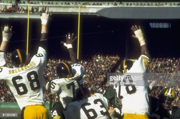 Football Pittsburgh Steelers LC Greenwood Joe Greene Ernie Holmes and Dwight White in action vs Green Bay Packers Green Bay WI