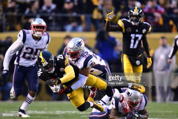 Pittsburgh Steelers Le'Veon Bell in action rushing vs New England Patriots Elandon Roberts at Heinz Field Pittsburgh PA CREDIT Fred Vuich