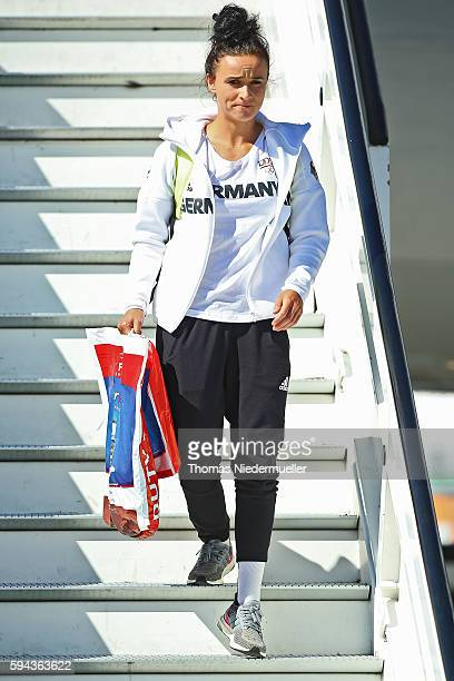 Football player and gold medailist Lina Magull is seen during the arrival of German Summer Olympic Athletes from the Olympic Games in Rio at...