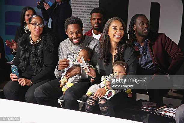 Football player Antonio Cromartie and Terricka Cromartie watch the runway show during BKLYN Rocks presented by City Point Kids Foot Locker and Haddad...