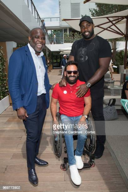 Football Player Basile Boli, Tennis Player Michael Jeremiasz and World Judo Champion Teddy Riner attend the 2018 French Open - Day Thirteen at Roland...