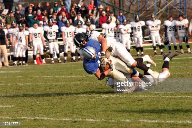A football player being tackled in a game